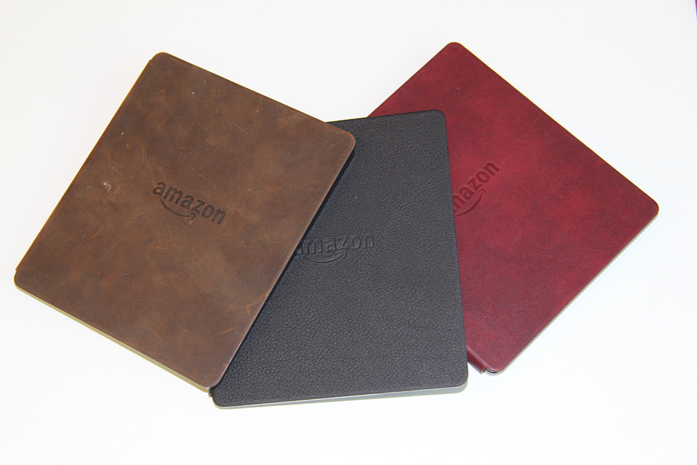 Электронная книга Amazon Kindle Oasis with Leather Charging Cover Walnut Wi-Fi + 3G (Special Offers). Фото N4
